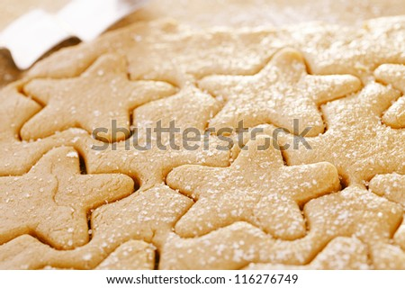 gingerbread  star cookie cuts dough, shallow dof - stock photo