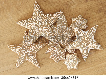 gingerbread stars on wooden background.