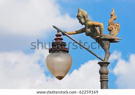 Ginnaree bronze streetlamp from Wat Suthat Thepwararam, Bangkok, Thailand - stock photo