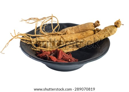 Ginseng and Matrimony vine in a bowl - stock photo