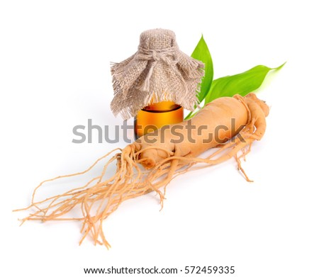 Ginseng root with pharmaceutical bottle and leawes. Isolated.