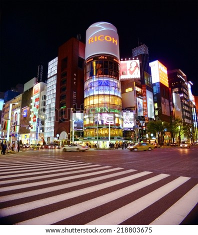GINZA, JAPAN - APRIL 8 : Ginza crossroad at night taken April 8, 2013 in Tokyo. Landmark of Ginza shopping area. The popular tourist spot in Tokyo. - stock photo