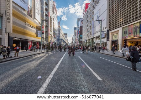 GINZA - TOKYO - JAPAN - 13 FEB 2016 : One of the main Shopping Walking Street in Tokyo during Weekend where All the Traffic is prohibited. There are many shops, retails, restaurants in this Area