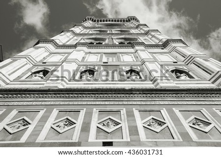 Giotto's Campanile - bell tower of Florence cathedral. Architecture in Italy. UNESCO World Heritage Site. Black and white retro photo. - stock photo