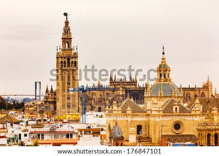 Giralda Spire Bell Tower Seville Cathedra, Cathedral of Saint Mary of the See Church of El Salvador Seville, Andalusia Spain.  Giralda is largest Gothic Cathedral in the World. - stock photo
