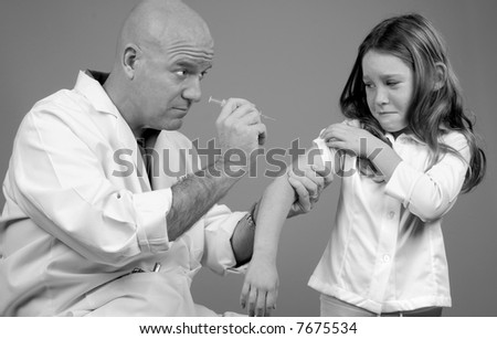 Girl About to Receive Shot in Doctor's Office - stock photo