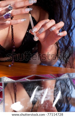 Girl about to snort a line of cocaine - stock photo