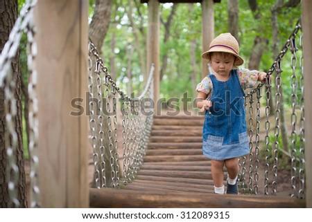 Girl across the bridge - stock photo