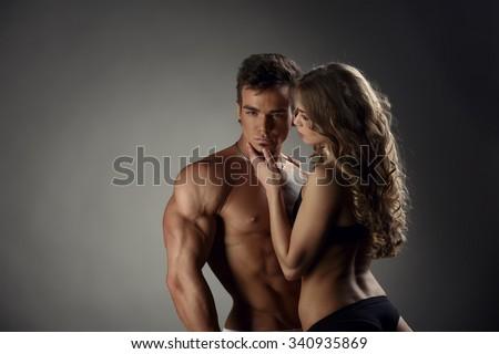 Girl admires hot guy and he posing at camera - stock photo