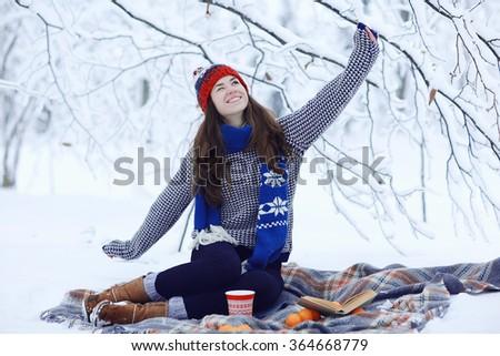 Girl adult tangerine winter snow, the concept of vitamins immunity - stock photo