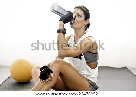 Girl after training drinks water - stock photo
