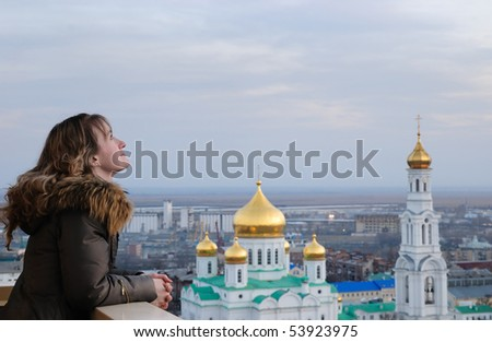 Girl against church. Russia. Rostov-on-Don. A cathedral of the Virgin. - stock photo