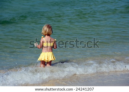 Girl alone on Florida Keys beach - stock photo