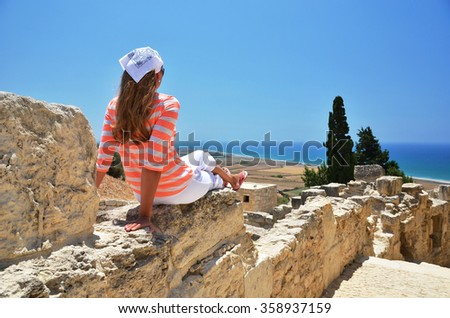 Girl among ancient ruines of Kourion in Cyprus - stock photo
