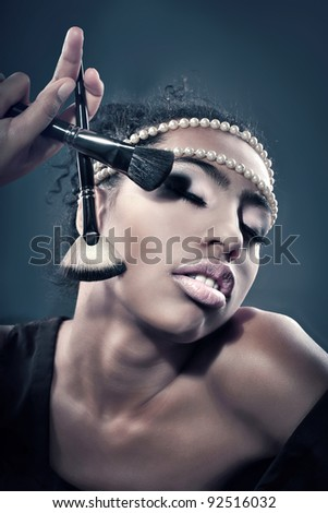 girl and a cosmetic brush
