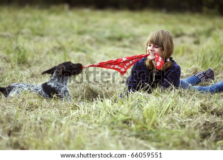Girl and a dog - good friends - stock photo