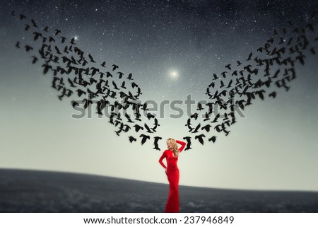 girl and a flock of crows. Elements of this image furnished by NASA - stock photo