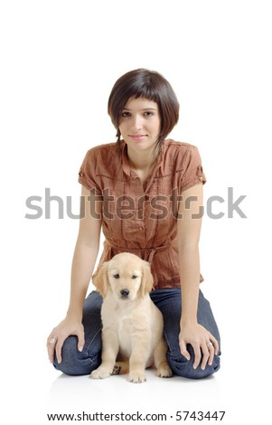 Girl and a golden retriever puppy - stock photo
