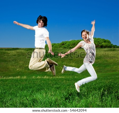 Girl and boy are jumping - stock photo