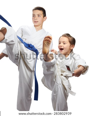 Girl and boy athletes are beating blow karate