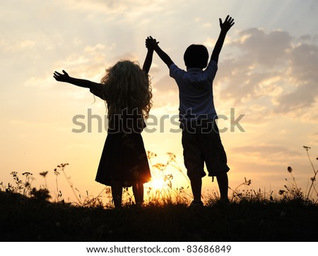 Girl and boy, couple love, children waiting for sunset