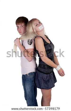 Girl and boy fighting on a white background - stock photo