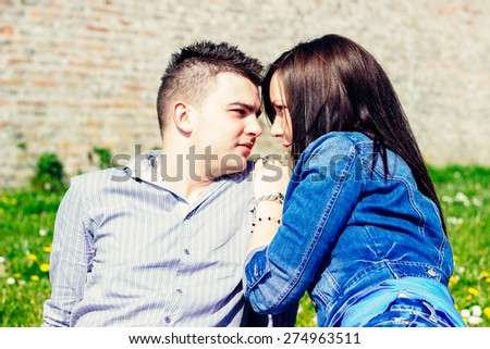 Girl and boy looking each other in the eye  - stock photo