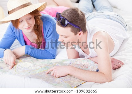 Girl and boy planning a journey with a map