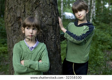 Girl and boy playing hide-and-seek - stock photo