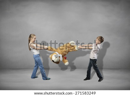 girl and boy pull a toy - stock photo