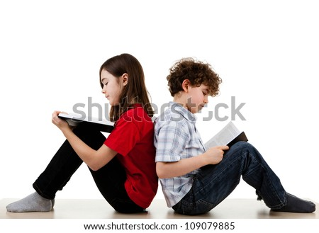 Girl and boy reading books on white background - stock photo