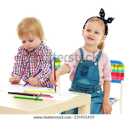 Girl and boy sitting at the table draw.Childhood education development in the Montessori school concept. Isolated on white background. - stock photo