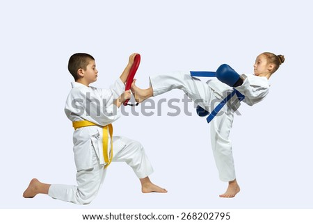 Girl and boy train kicks  - stock photo