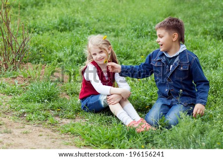 girl and boy with flowers - stock photo