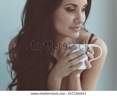 girl and coffee in the morning - stock photo