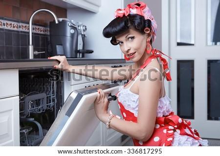 Girl and dishwasher - stock photo