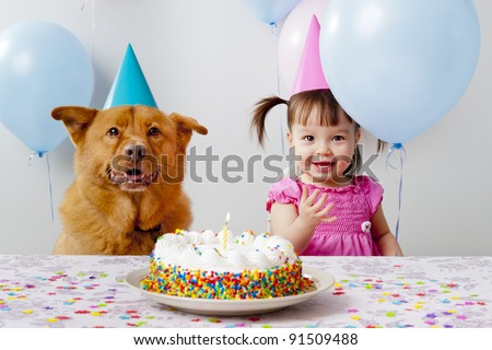 Girl and dog celebrating birthday - stock photo