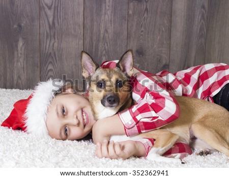 girl and dog, christmas - stock photo