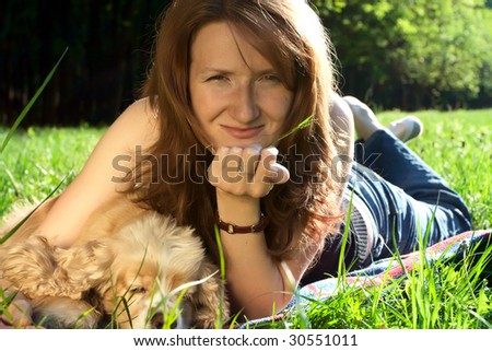 girl and dog on a meadow