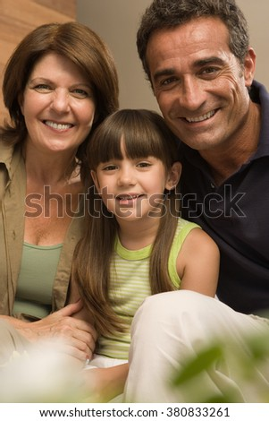 Girl and grandparents - stock photo