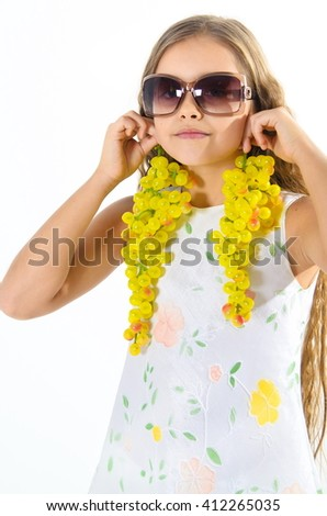 Girl and grape. Beautiful girl holding two bunches of grapes. Girl playing with grapes, cheerful girl eating grapes. girl in white dress and sunglasses on a white background - stock photo
