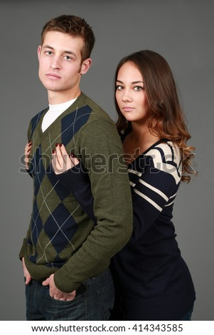 girl and guy fashion models on gray background