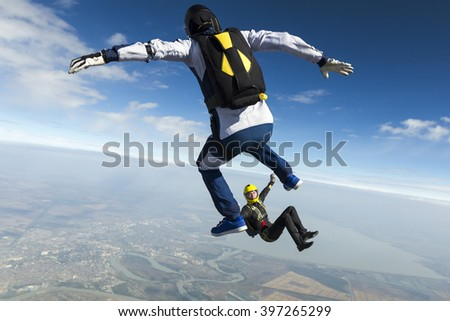 Girl and guy skydivers in freefall. - stock photo