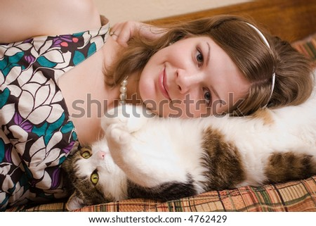 Girl and her cat - stock photo