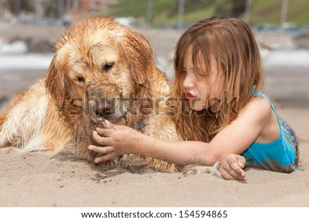 girl and her dog at the beach - stock photo