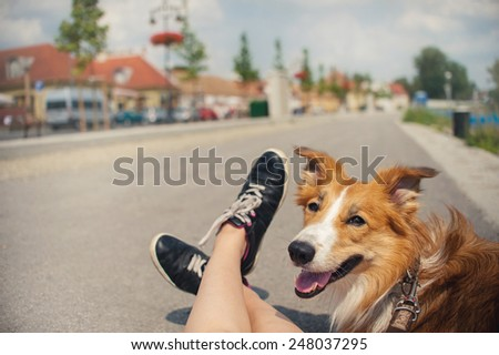 girl and her dog traveling in summer