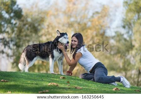 girl and her faithful dog - stock photo