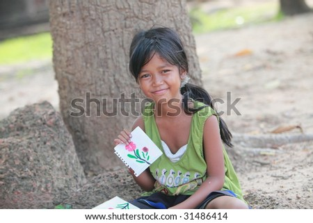 Girl and her paintings - stock photo