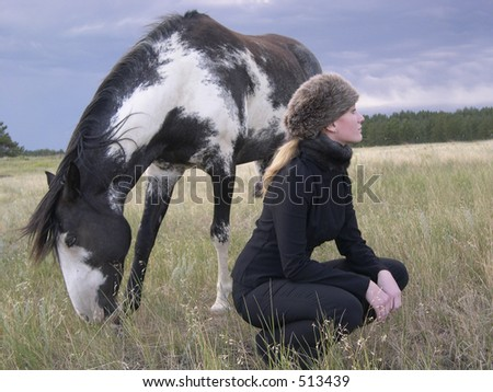 girl and horse in landscape dreamy lighting - stock photo