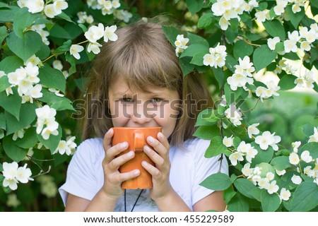 Girl and jasmine flowers - stock photo